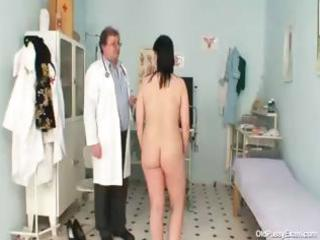naughty gyno doctor examines the hairy snatch of