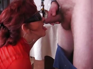 mature wench drinking and engulfing cock!