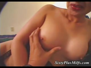 sexy granny toying with sex tool