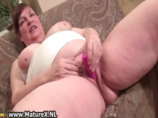old breasty mama acquires large pink dildo which