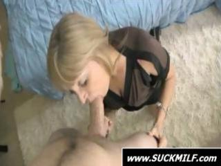 golden-haired mamma is on her knees and giving