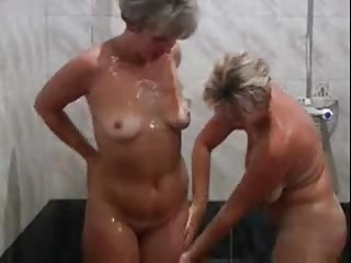two hot mature lady with a youthful boy