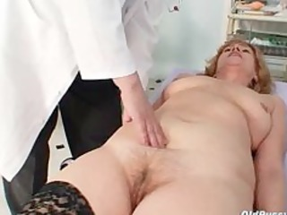 redhead messy cookie stretching in gyn clinic