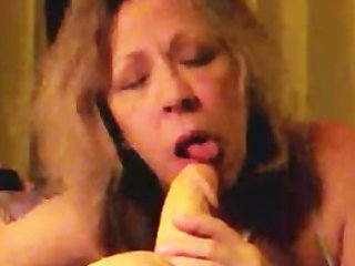 excited aged wife sucks a squirting sex-toy lazily