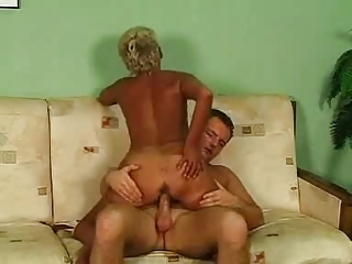 golden-haired granny in glasses and nylons fucks
