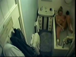 my cute mama masturbates in washroom tube. hidden