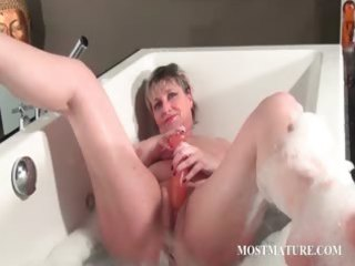 naughty older masturbates in bathtub