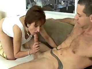 older beauty in high heels gives her stud a