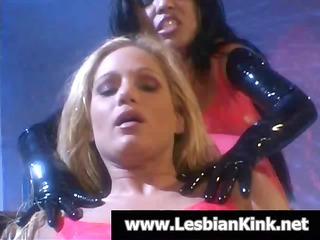 sexy blonde and ebon lesbians in latex rubbing