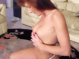 slender aged lady rubs her pantoons with lotion
