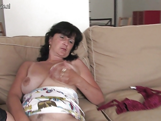 mature housewife playing with her vibrator and