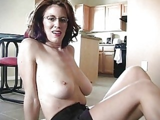 sporty busty redhead momma works on her pounder