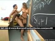 older brunette teacher on her desk