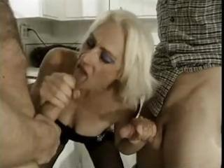 horny blond granny takes on youthful males and