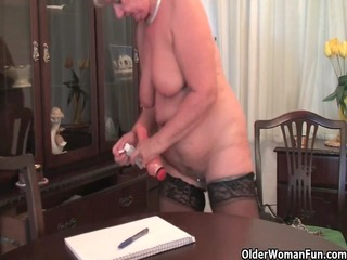 bulky granny in nylons plays with fake penis