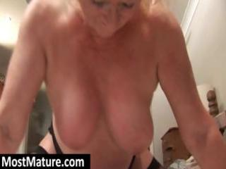 chunky blond granny squeezes her big titis and