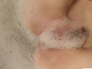 redhead mommy pleasures her soapy cunt