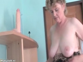 slutty busty older woman puts her bra buddies