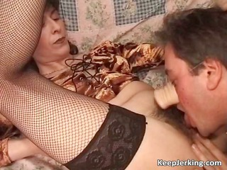 excited dude licks unshaved bush of his lady