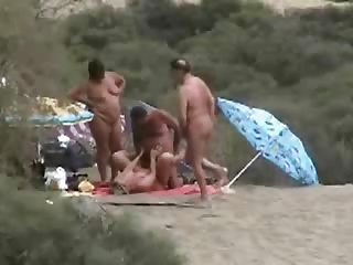 aged couples having fun at bare beach